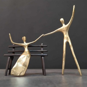 Wonderful bronze sculpture featuring a couple celebrating their propposal