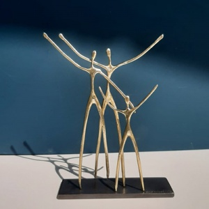 Original hand made bronze sculpture featuring a couple with a kid and their arms open by internationally acclaimed Greek artist Anna Andreadi